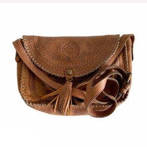 Patricia Nash tooled distressed leather saddle bag